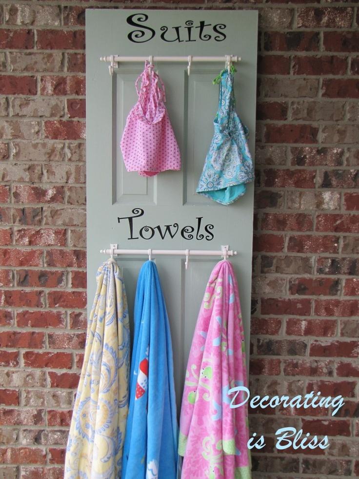 old door turned in to towel/swim suit hanger. Great idea!