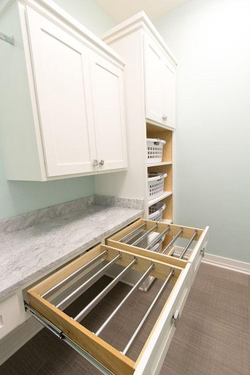 laundry room w/ pull out drying racks. Put in chubby bars and then you dont have the dried line across your chest!