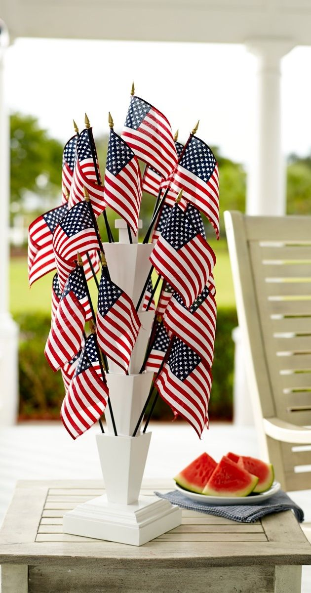 Show your patriotic spirit with our Parade Flags and Stand. Carry individual flags off to a parade, or create a festive arrangement for a party or picnic using our white wooden Flag Stand.