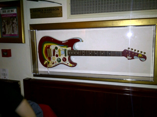 George Harrison's painted Fender Stratocaster at the Hard Rock Cafe, Amsterdam. For more guitar related news and features, visit http://www.guitarjar.co.uk