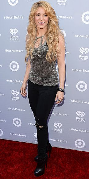Is it any wonder she wrote an entire song about those hips? Shakira rocks curve-hugging ripped black jeans and a slinky silver tank top at the iHeart Radio release party for her latest album in L.A.