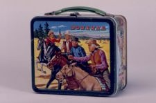 """Bonanza"" Lunch Box: This lunch box features imagery based on the TV western ""Bonanza"" which aired from 1953-1964 on NBC. ""Bonanza"" aired 430 episodes, and is one of the longest running shows of all time. ""Bonanza"" held the number one spot on the Nielsen ratings chart from 1964-1967."
