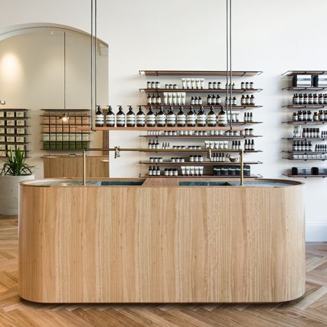 Genesin Studio designed a pale wood and antique marble interior behind a dusky-green Victorian shopfront for Aesop's new Adelaide store.