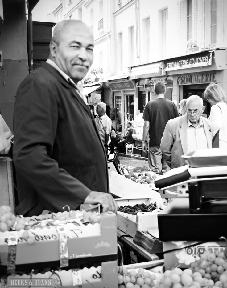 Happy vendor at the Paris Market where Picasso used to get his fruits and veggies.