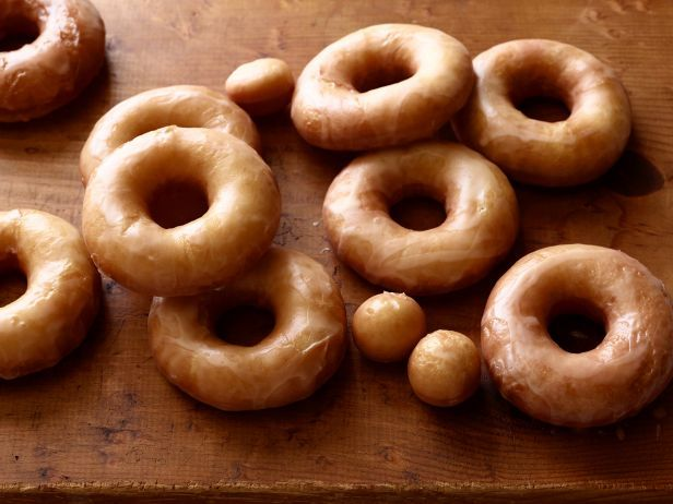 Homemade glazed doughnuts are the ultimate breakfast. To make the most of the glaze, set the hole underneath the doughnuts so they can catch the extra good stuff.