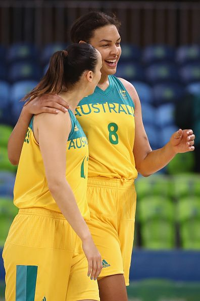 Laura Hodges and Elizabeth Cambage of Australia celebrate victory during the Women's round Group A basketball match between Australia and Belarus on...