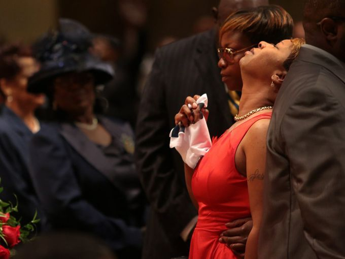 Lesley McSpadden, mother of Michael Brown, is held by an unidentified woman.