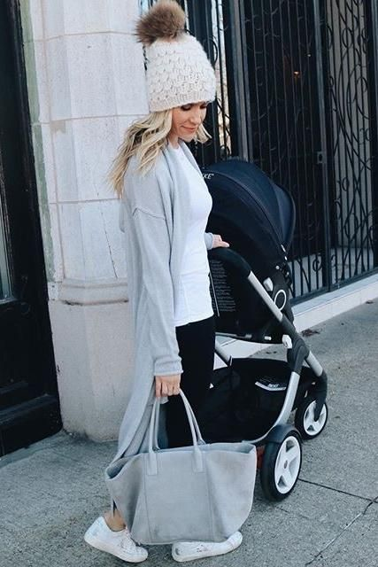 Kristin Cavallari wearing Sh*T That I Knit Gunn Beanie in White Lie, Golden Goose Superstar Sneakers, Aerin Suede Boat Tote and Stokke Crusi Stroller