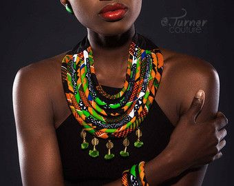 This Extra large striking piece is great for starting conversations and standing out in the crowd! This handmade necklace is made with 100 % cotton African Wax print fabrics. - Necklace Closure - ties in the back to ensure comfort and give the ability to wear at different lengths.  Note: Each item is handmade, due to variances in the fabric print each item may look slightly different than the one pictured. No two items will look exactly the same, thus creating a custom look just for you…