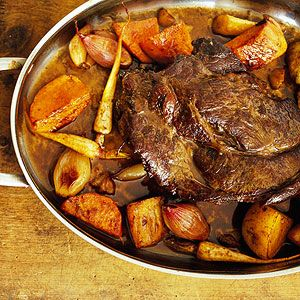 Sunday Oven Pot Roast An oven or slow cooker turns an inexpensive beef pot roast into a succulent, tender feast. Vegetables cooked with the roast make for a simple, but filling meal.