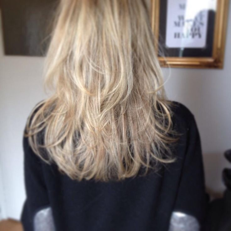 Cool shades of blonde on a gorgeous shaggy style.