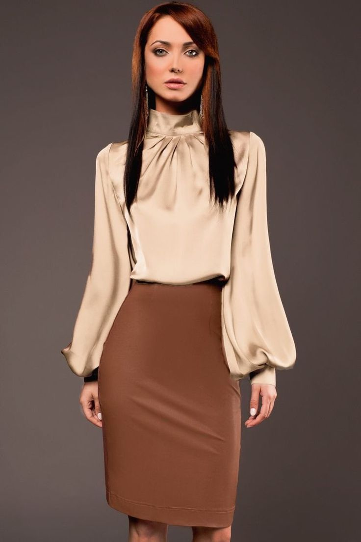 Love puffy sleeved shirts and fitted skirt. This outfit is gorgeous.