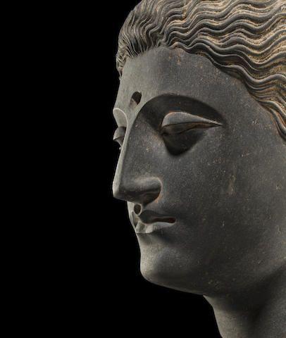 "A carved schist head of Buddha Ancient region of Gandhara, 3rd/4th century 11-3/4"" USD 209,000"