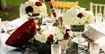 Table arrangement examples. Here you can see that we are using African Chic, yet still encompassing what South African 'gees' is all about using the vuvuzella.