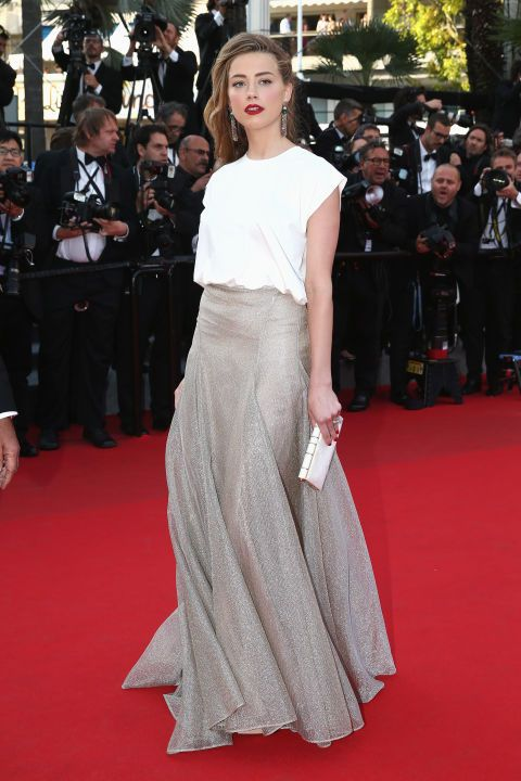 Heard brings the white T-shirt to Cannes and makes it feel right at home by styling it with a fanciful silver skirt.