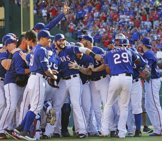 The Texas Rangers celebrate clinching the Western Division with a 9-2 victory over the Los Angeles Angels vs. the Texas Rangers major league baseball game at Globe Life Park in Arlington on Sunday, October 4, 2015. (Louis DeLuca/The Dallas Morning News)
