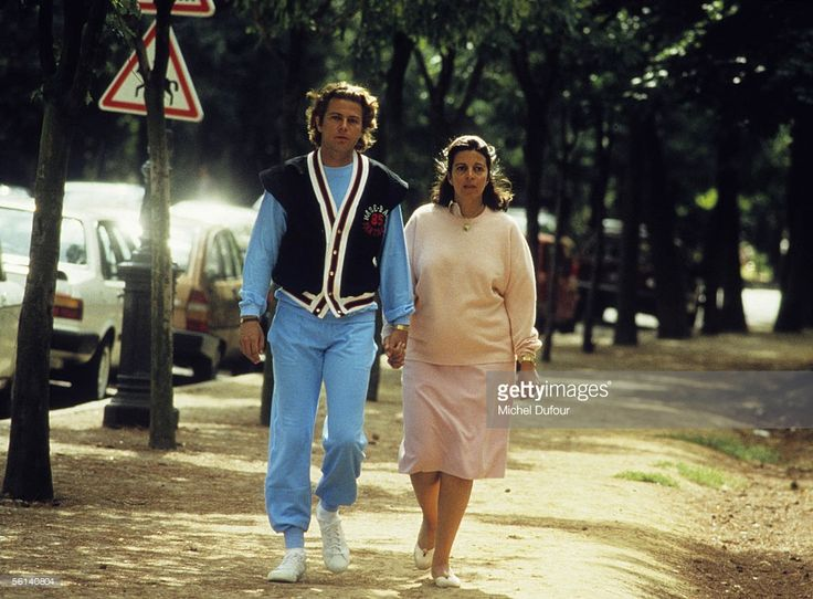 Christina Onassis, daughter of Greek shipping magnet Aristotle Onassis, takes an afternoon stroll with Thierry Roussel on Avenue Foch in Paris, France.