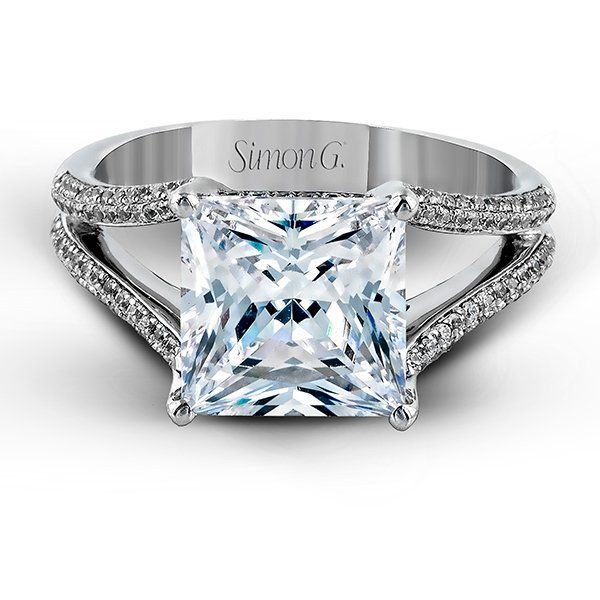 Princess-cut diamond engagement ring by Simon G. accentuated with round-cut diamonds in an eye-catching openwork design.
