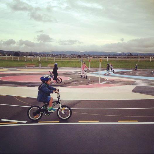 Aaah, school holidays! The perfect time for fresh air and a family bike ride. But where to take littlechildren tospin their wheels and get their wiggles out, especially if they're still getting the hang of riding in a straight line? It might seem paradoxical, but for starters,take them toschool,if you're lucky enough to have a local school that leaves its gates open for visitors. What a treat to have allthose lovelysmooth sports courts tosail around without bumping into anyone…