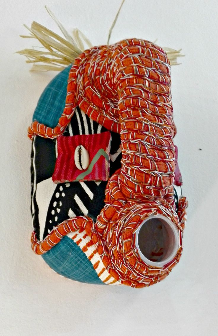 contemporary take on the African mask, 5 l plastic container upholstered with hand painted textile, crocheted braids made in Cape Town