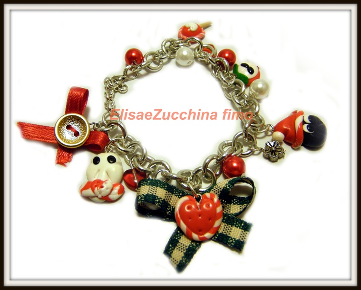 Bracelet with polymer clay charms, glass and metallic beads, bows and buttons by www.elisaezucchina.blogspot.it