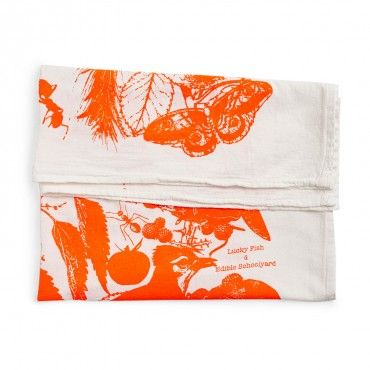 Lucky Fish Neon Orange Tea Towel  Maintaining the artisanal craft of hand silkscreen printing, nature-inspired designs are printed on flour sack cloth in vivid neon colors. Designed by Jann Cheifitz in her Brooklyn studio.