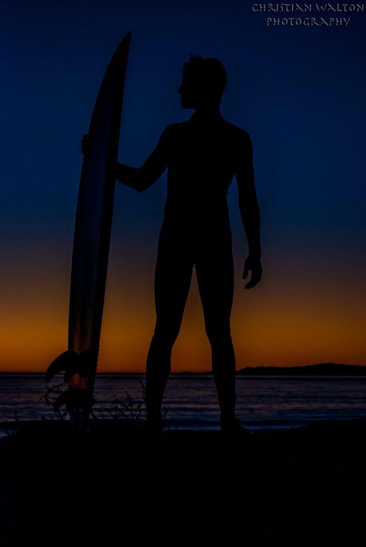 Silhouette sunset surfer