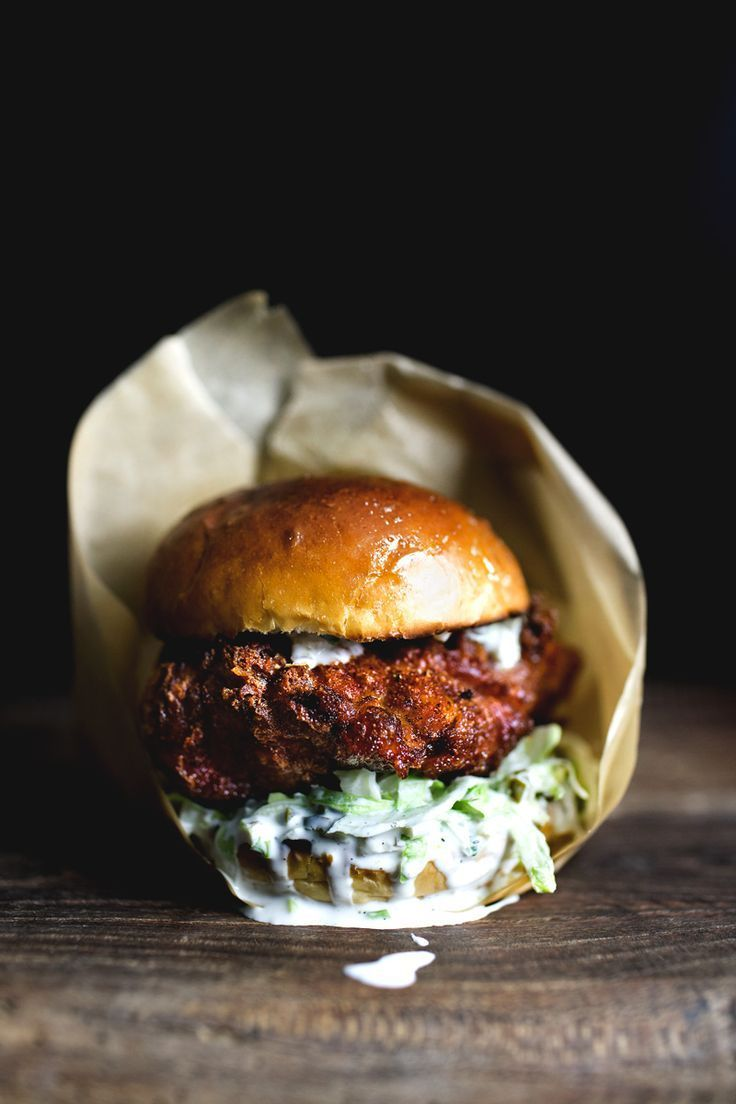 Spicy fried chicken sandwich made with brined chicken coated in a sriracha batter and dressed in jalapeno yogurt mayo.