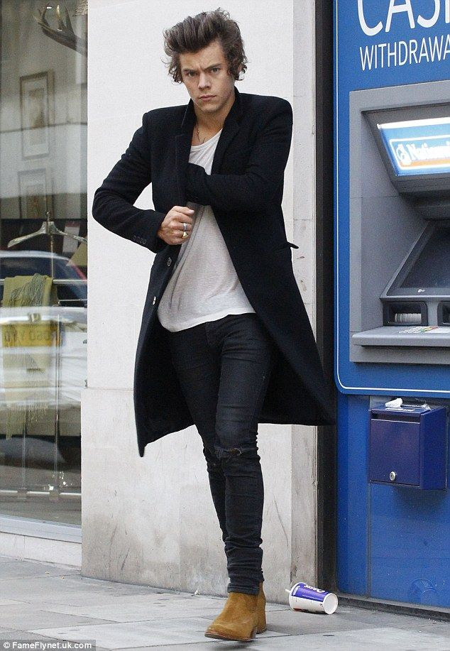 Stocking up: Harry gets some of his fortune out of a cash machine as he heads out on the town