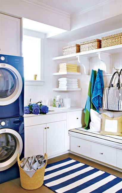 Love the blue & white rug with blue washer and dryer!