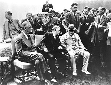 US President F.D. Roosevelt, Canadian PM W.L.M. King and British PM Winston Churchill at Québec on August 1943. Credible because it comes from the Canadian Encyclopedia and has the date it was taken listed. It tells us that these three leaders were meeting most likely because of the war and that life was getting difficult at this time.