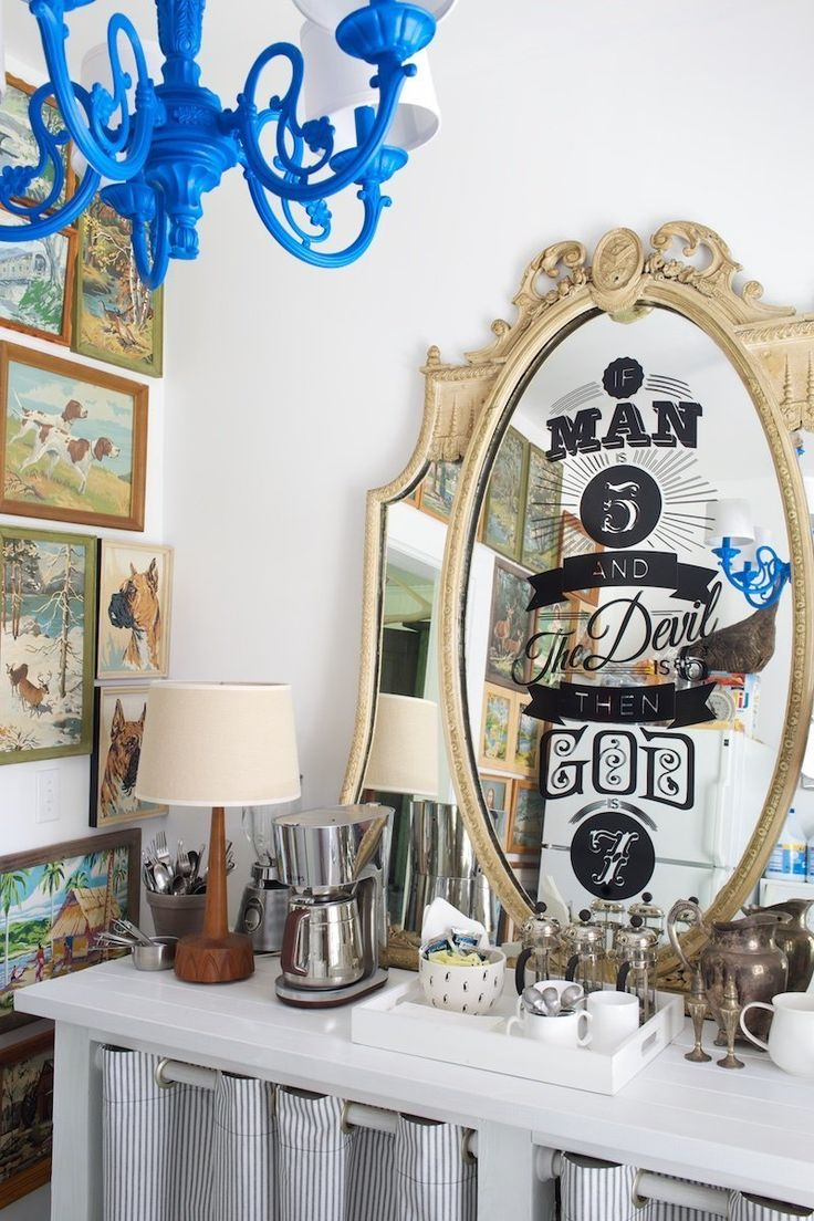 The mirror in the pantry is from an old hotel and features one of Chris' favorite DIYs in the home: Lyrics from one of his favorite Pixies songs as a vinyl decal.