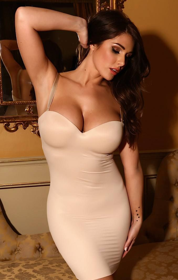 She looks like Lucy Pinder to me.