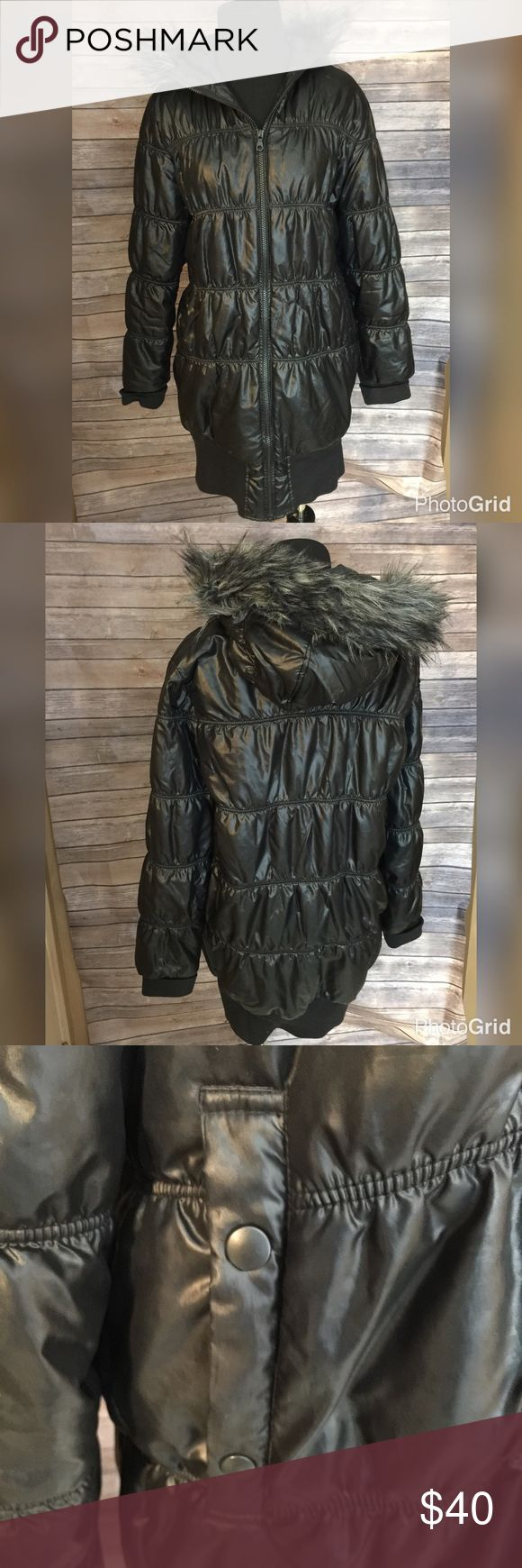 Uniqlo faux fur trimmed jacket 33 inches long, that hugs on the bottom, to keep the cold out.  Faux fur trimmed hood.  In great condition Uniqlo Jackets & Coats