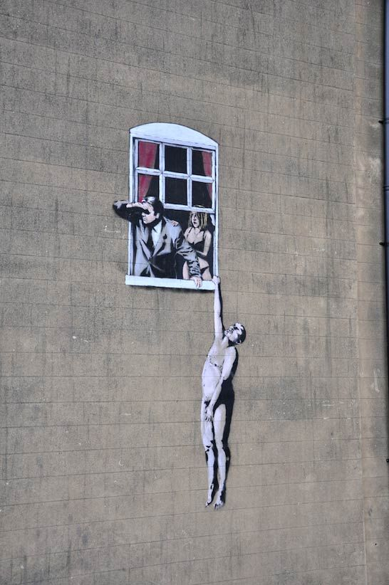 BRISTOL CENTRE, BANKSY Because of it's placement this has to be the most viewed and photographed Banksy piece in Bristol. You can find at the bottom of Park Street.