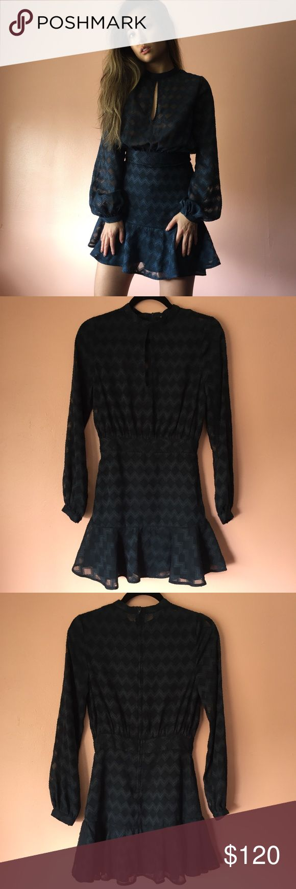 Finders Keepers Midnight LS Mini Dress Shimmy into the night with this midnight long sleeve mini dress by Finders Keepers. Features a crewneck, keyhole, long full cuffed sleeves, fitted waist, flounce hem in textured midnight fabric. Wear with heeled boots. MSRP $190. New with tags. Fits like an XS-S. Label missing. No returns allowed. Please ask all questions before buying. IG: [at] jacqueline.pak #finderskeepers Finders Keepers Dresses Mini