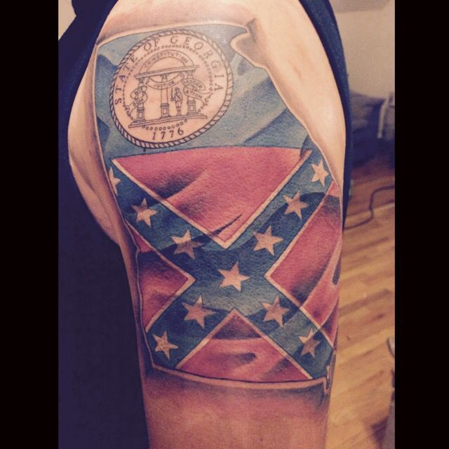 State of Georgia with the old state flag inside. Pretty damn cool. Hurt like hell though.
