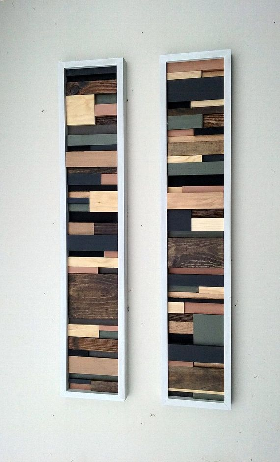 Wood Wall Art Set of Two Wall Sculptures This is a set of two wall art sculptures made of wood scraps. They have been painted and stained in earth tone colors. Hang them together side by side vertically or horizontally. Finished with a wood frame in white. These two abstract wall sculptures will brighten up any room! Available and ready to ship! Size: Each one measures 40 long and 8 wide To check out more wall art in my shop click the link below: https://www.etsy.com/shop/ModernRusticAr...