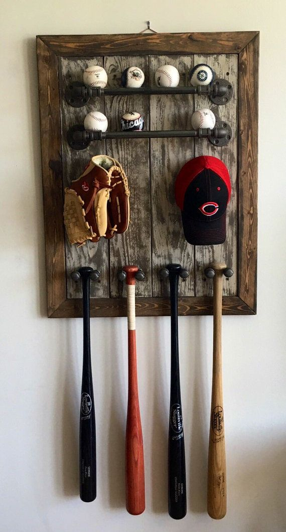 Industrial pipe and rustic reclaimed wood baseball wall decor. Display all your favorite sports memorabilia in a cool rustic design with a modern urban twist. Perfect gift for any guy in your life. Can be custom made, various sizes, colors, and pipe options. Please contact me for more details.   Check out the rest of my shop on etsy under the name: UrbanstylesShop Thanks for checking out my work. - Christina