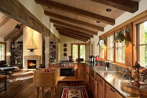rustic kitchen interior ceiling beams wood cabinets stainless steel countertop  open plan kitchen