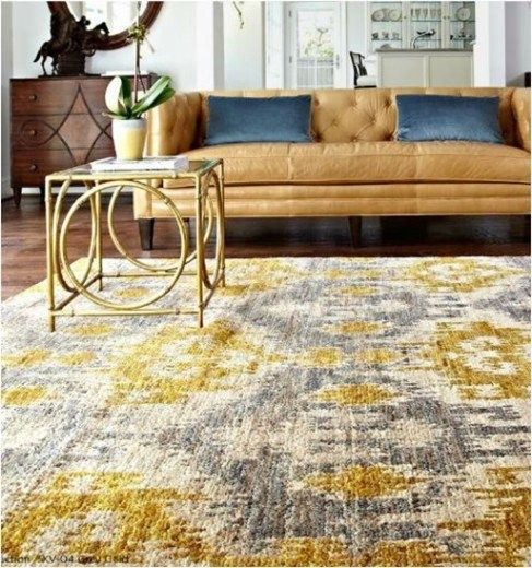 Yellow and gold rug for the sunroom.