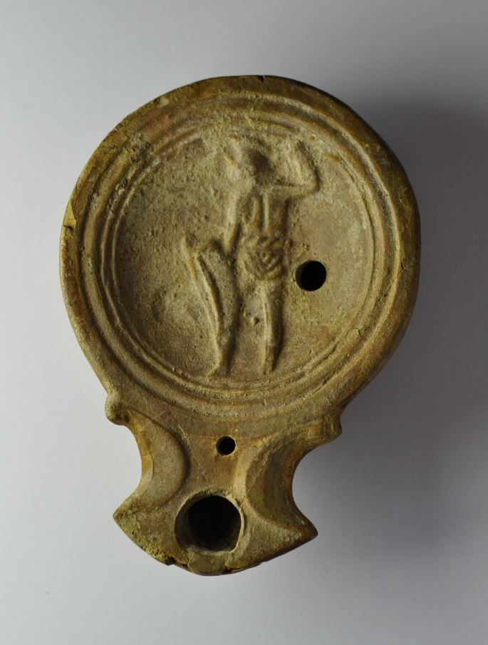 Roman oil lamp with gladiator, 1st-2nd century A.D. Roman oil lamp with gladiator represented probably during Colosseum gladiator fight, 9 cm long. Private collection