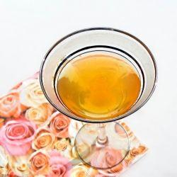 Wedding Cake Martini - 3 ozs Amaretto, 1/2 oz vodka, 1 0z fresh orange juice. You can float cream on the top if you wish!