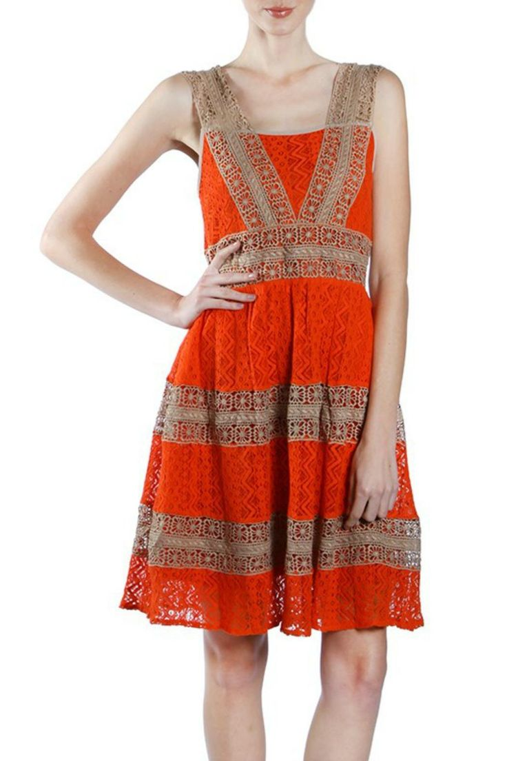 Bright orange lacy dress with warm taupe crochet trim.  This adorable dress is fully lined and has a crinoline layer.  Perfect for a casual wedding, cocktail party or a fun day out.   Orange Crochet Dress by Ryu. Clothing Portland, Oregon
