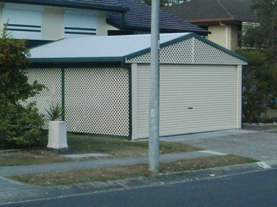colorbond steel garage screen with lattice in classic cream and border in cottage green enclosed