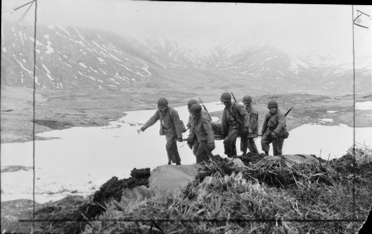 The recapture of the Aleutian Islands in the Northern Pacific May 1943: American soldiers carry a wounded comrade to safety during the fighting on Attu Island.