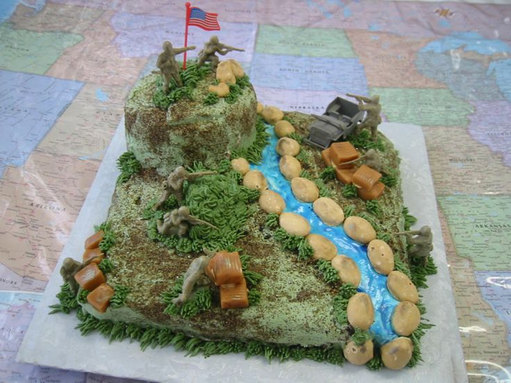 """Battle Scene Birthday - Buttercream, with plastic toy army men ... and little silver sprinkles ... the cake was rather depressing when I sprinkled the """"bullets"""" on the cake ..."""