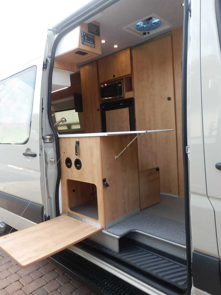 7aa309426f Ford Transit camper conversion featuring a galley with inside and outside  access