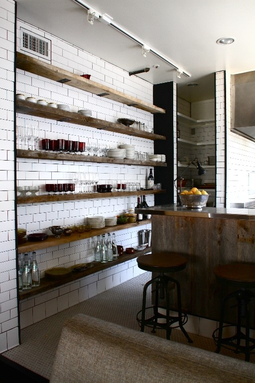 Venice Beach kitchen. subway tile to the ceiling + heavy wood shelves.