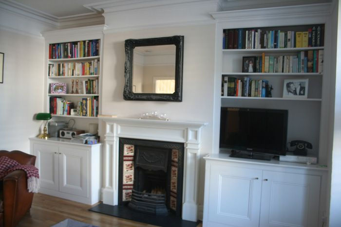 minimalist fireplace and mantle, but still traditional